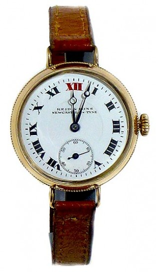 TRENCH WATCH BY REID AND SONS 9CT GOLD CASE SCREW FRONT CIRCA 1917